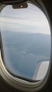 Pemandangan garis pantai Sumatera dari jendela Garuda